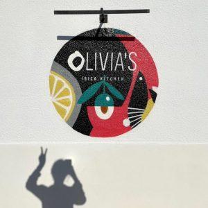 Wallpainting of Olivia's Ibiza Kitchen Logo and coporate Illustration.