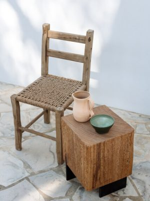 Different hand made custom-made ceramic pieces by Laura de Grinyo displayed on a wooden table